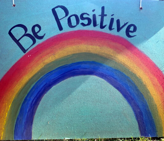 painted rainbow sign