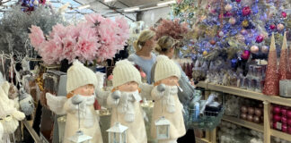Ladies browse Xmas decorations Polhill garden centre Kent