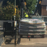 Flatbed truck delivery of building supplies, Hampshire