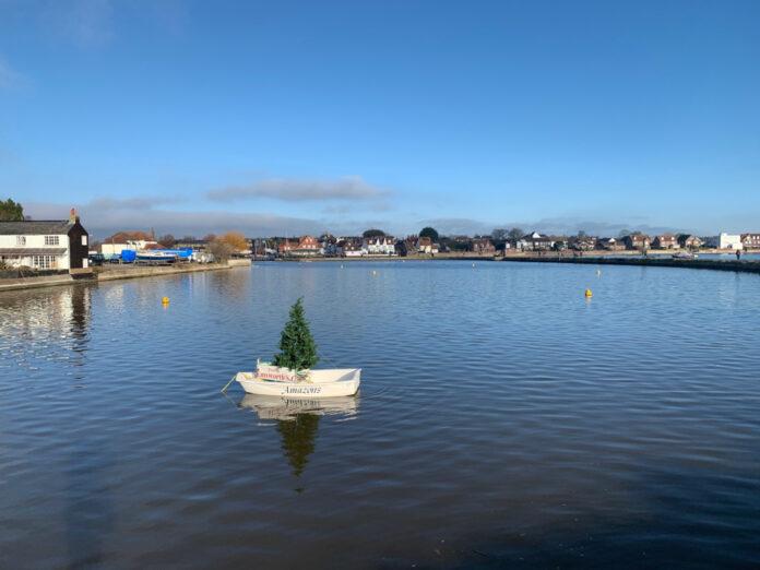 Xmas tree in boat Emsworth Mill Pond