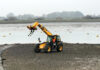 JCB on shore Chichester Harbour Sussex