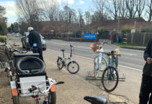 Bicycles in front of bike shop next to A road in West Sussex