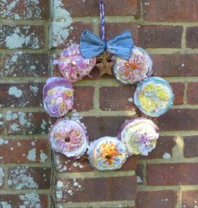 Flower wreath blue bow by Create Display