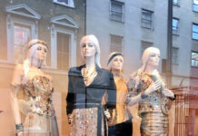 'Mannequins in gold outfits with city terraces' photo by A Howse